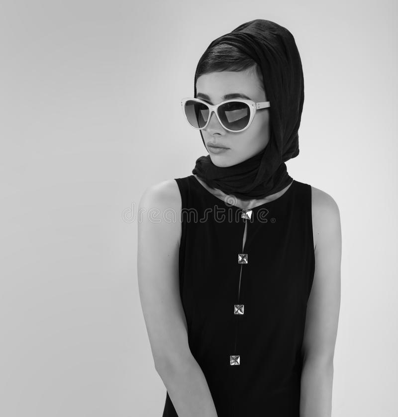 beautiful-young-woman-retro-style-sunglasses-head-scarf-black-white-photography-97255122.jpg